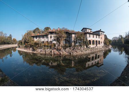 Country house along the Naviglio Grande of Turbigo (Milan Lombardy Italy) at fall. Fisheye