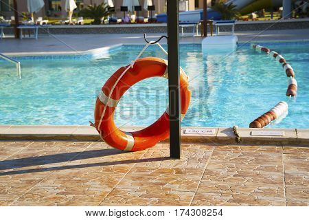 Life buoy at the swimming pool. Concept of safety.