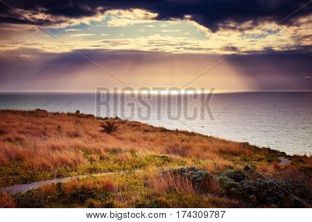Fantastic view of the overcast sky. Dramatic and gorgeous morning scene. Location place cape Milazzo, nature reserve Piscina di Venere. Island Sicilia, Italy, Europe. Tyrrhenian sea. Beauty world.