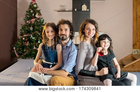 Portrait of a smiling family at Christmas time