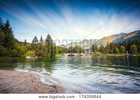 Vivid view of the church Sv. John the Baptist in sunny day. Picturesque and gorgeous scene. Location famous place Triglav national park, Bohinj valley, Julian Alps, Slovenia, Europe. Beauty world.