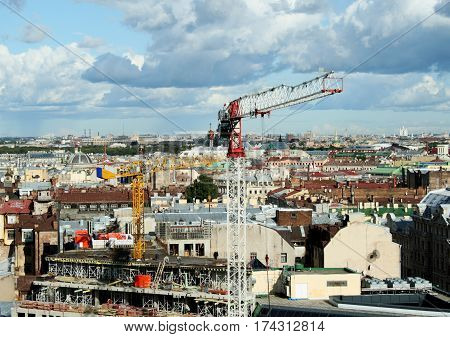 Cranes on the background Saint Petersburg Skyline. Step into the future, development of older districts of the city. Modernization of the historic center of the city. Horizontal location.