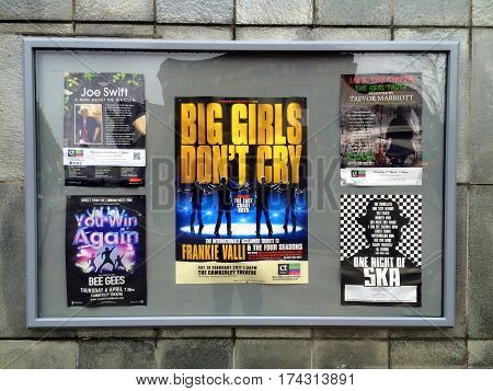 Camberley, England - January 30, 2017: Poster display for current and future productions at the Camberley Theater in England