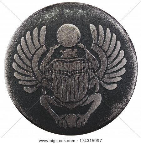 Scarabaeus carved in silver coin isolated on white background, an Anciant egyptian scarab beetle