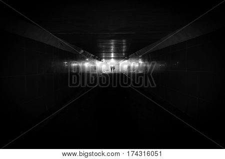 silhouette in a subway tunnel. Light at End of Tunnel