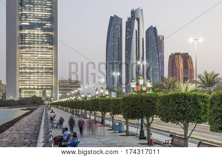 ABU DHABI UAE - NOV 26 2016: People stroll at the corniche of Abu Dhabi United Arab Emirates