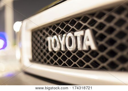 ABU DHABI UAE - NOV 26 2016: Toyota company logo on a car illuminated at night