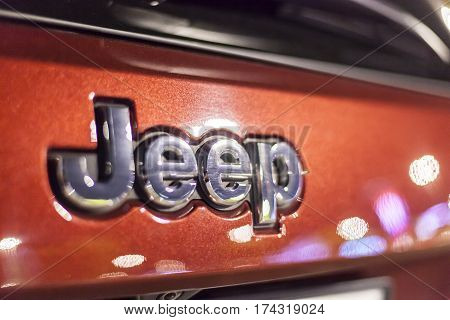 ABU DHABI UAE - NOV 26 2016: Jeep company logo on a car illuminated at night