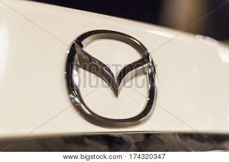 ABU DHABI UAE - NOV 26 2016: Mazda company logo on a car illuminated at night
