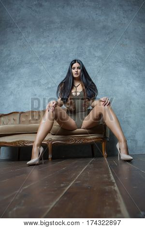 attractive cute model girl pose on luxury sofa