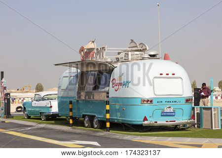 DUBAI UAE - NOV 27 2016: Airstream caravan converted to a food truck at the Last Exit food trucks park on the E11 highway between Abu Dhabi and Dubai