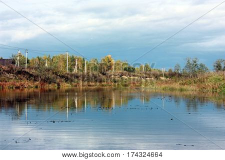 Autumn Landscape. The River In Which Is Reflected Sky And Clouds