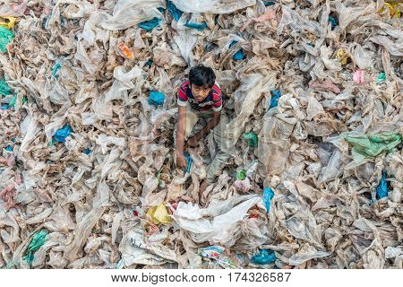 Little Child Stands In The Garbage