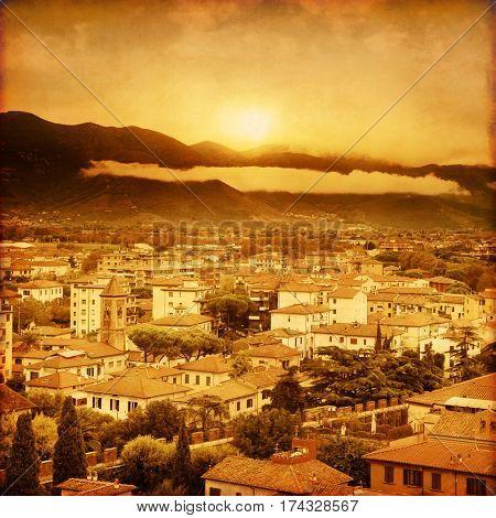 Pisa at sunset. Tuscany. Italy. Grunge style image.