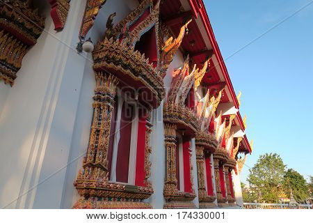 Red windows at a temple in Thailand