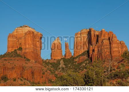 a full moon rising over scenic cathedral rocks Sedona Arizona