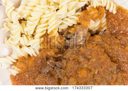 Beef Goulash With Pasta Served On A Plate
