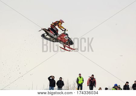 Tyumen Russia - March 08. 2008: IV stage of personal-team Championship of Ural Federal district in over-snow cross-country. Jumping of sportsman on snowmobile
