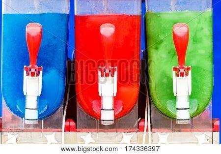 Food cold sweet desert summertime pleasure concept. Colorful ice cream slushy smoothie machine