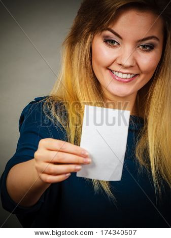 Happy Woman Looking At Piece Of Papier
