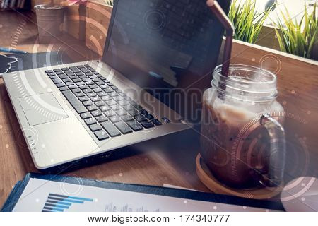 Double Exposure Of Computer On The Table Inside Coffee Shop.