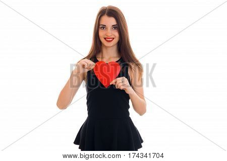 beautiful young girl in black dress holding a postcard sweetheart looks into the camera and smiling isolated on white background