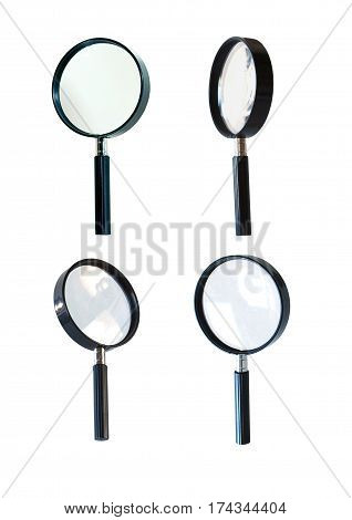 Close up of four loupes in different positions on white background