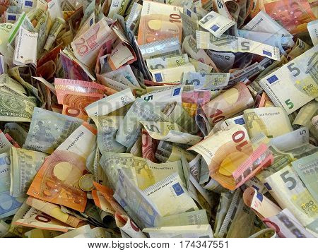 pile of banknotes from different countries (euros and dollars)