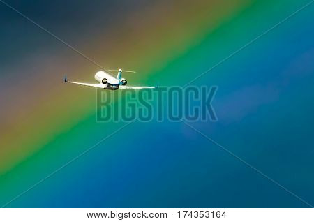 Airplane taking off at the airport sky and rainbow rain.