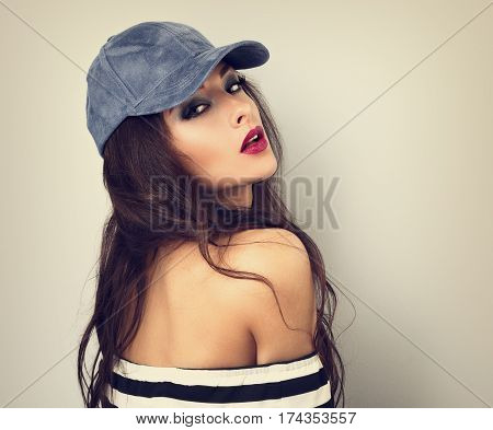 Beautiful Sexy Young Make-up Model Posing In Blue Cap With Long Hair Style. Red Lipstick. Toned Vint