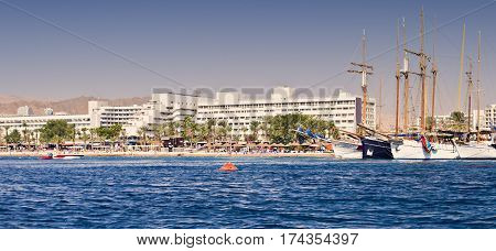 Central public beach and marina in Eilat - number one resort and recreational city in Israel located on the Red Sea