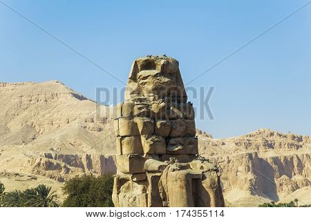 Ancient Colossi Of  Memnon In Luxor, Egypt