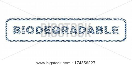 Biodegradable text textile seal stamp watermark. Blue jeans fabric vectorized texture. Vector tag inside rounded rectangular shape. Rubber sign with fiber textile structure.