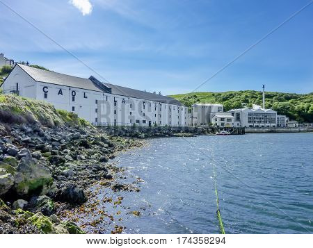 ISLAY, SCOTLAND - JUNE 2, 2014: Whisky storing in the houses of Caol Ila close to the Atlantic waters
