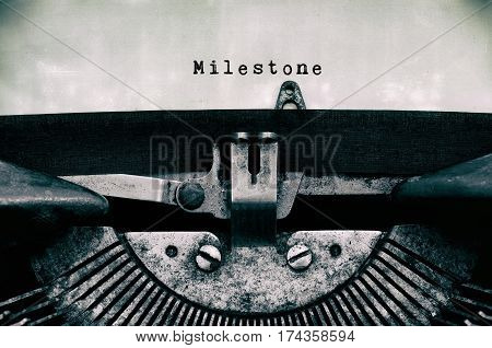 Milestone Words Typed On A Vintage Typewriter In Black And White.