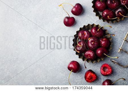 Black Cherries In A Bowl. Copy Space. Top View