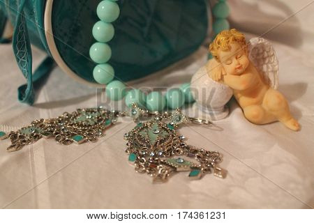 figure of little sleep angle,  pair of silver earrings turquoise beads goods for beautify and decoration