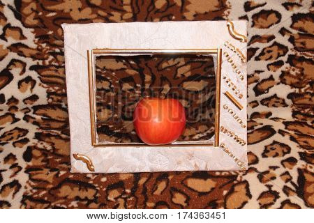 red juicy ripe apple( real) stay in white frame for decoration and painted lesson