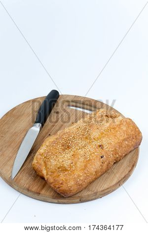 Puff Pastry On The Wooden Kitchen Board With Knife