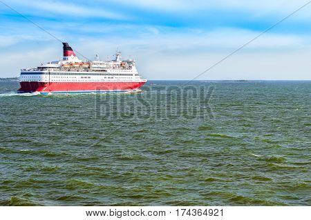 Cargo-passenger cruise ferry goes from port Helsinki across Bay Kruunuvuorenselka near island Suomenlinna. Suomi Helsingfors South Gulf