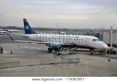 WASHINGTON DC - DEC. 11, 2010: US Airways Embraer 175 at Ronald Reagan Washington National Airport (DCA) in Washington DC, USA.