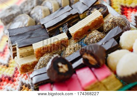 Colorful And Delicious Home Made Small Cakes Arranged On Glass Plate
