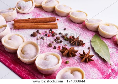 Dumplings Home Cooking In A Bright Pink Board With Flour And Seasonings. Colorful Board With Dumplin