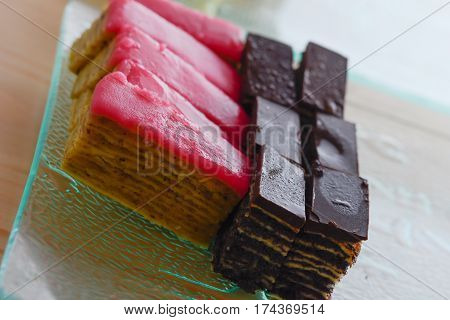 Colorful And Delicious Chocolate Home Made Small Cakes Arranged On Glass Plate