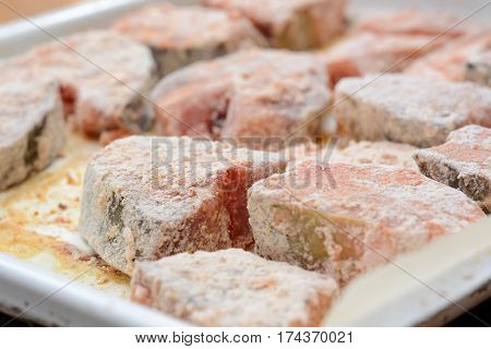 Fish Steaks Covered With Wheat Flour And Bread Crumbs