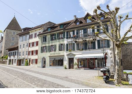 RAPPERSWIL SWITZERLAND - MAY 10 2016: Buildings along a cobblestone side streets. Many windows are equipped with shutters.