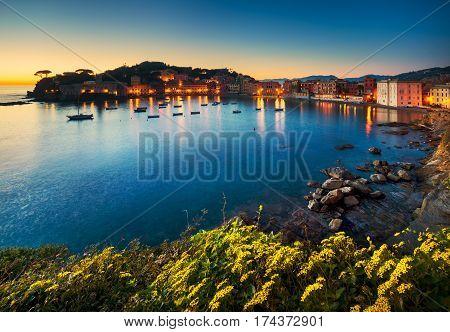 Sestri Levante silence bay or Baia del Silenzio sea harbor and beach view on sunset. Liguria Italy Europe.
