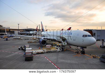 TOKYO - JUN. 14, 2012: Delta Boeing 767-332(ER) in airport at sunset at Tokyo Haneda Airport (HND), Tokyo, Japan.