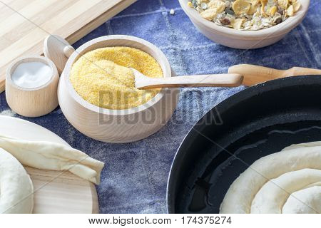 Corn Flour In The Wooden Bowl With Wooden Spoon.