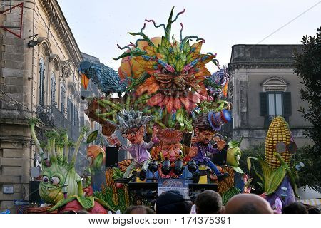 Acireale (CT) Italy - February 28 2017: allegorical float depicting a large head and other characters all in the shape of vegetables during the carnival parade along the streets of Acireale.